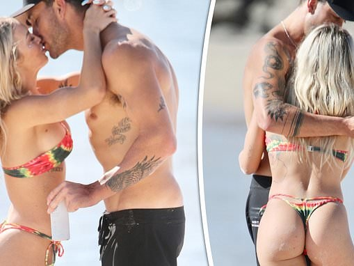 Tammy Hembrow and new boyfriend Matt Poole can't keep their hands off each other at Currumbin Beach