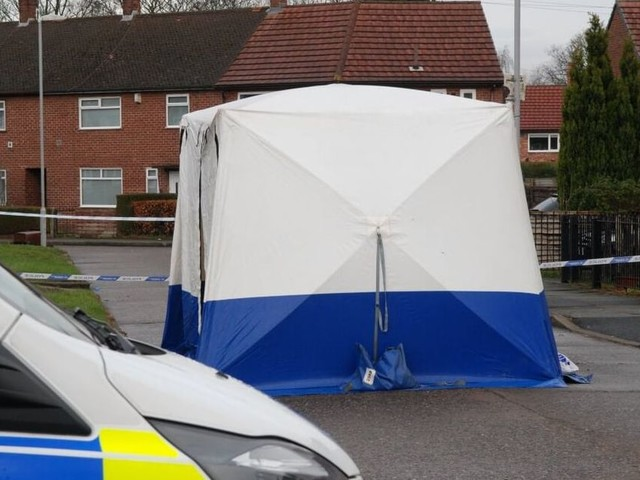 Police are searching gardens and going door-to-foor after a man was stabbed in Wythenshawe