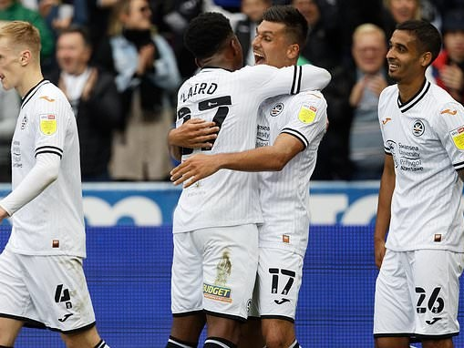Swansea 3-0 Cardiff: Swans run riot in South Wales derby to inflict SIXTH straight defeat on rivals