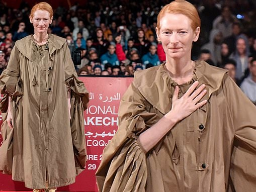Tilda Swinton continues to showcase her eccentric style in a billowing coat dress