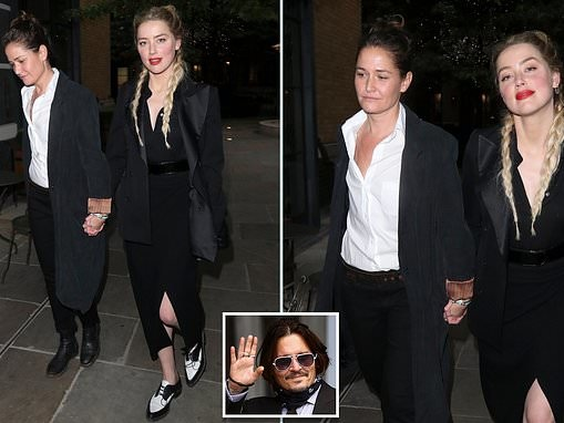 Smiling Amber Heard arrives back at her London hotel after seventh day of High Court libel trail