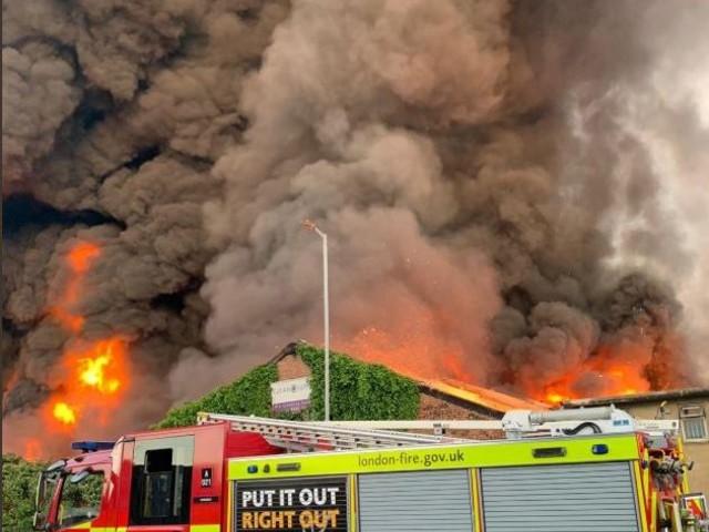 Tottenham fire – 100 firefighters battle huge warehouse blaze in North London