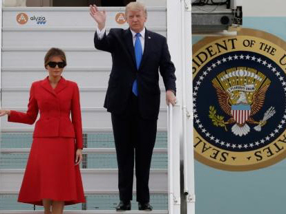 Trump arrives in Paris with Russia scandal in tow