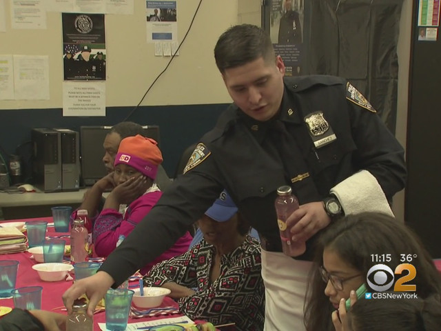 42nd Precinct Police Officers Treat Some Neighbors To Early Thanksgiving Feast