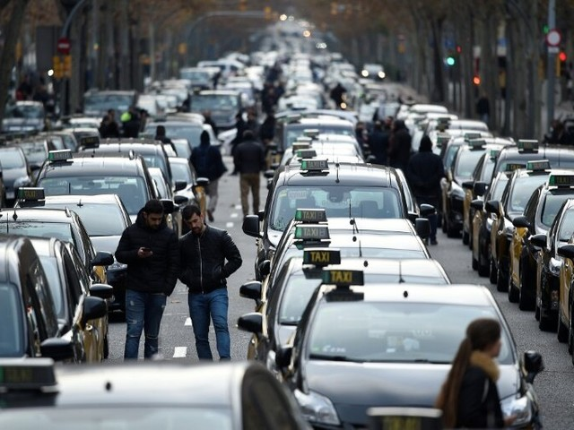 Barcelona taxis go on strike, block major street