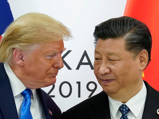 'Sorry! It's the way I negotiate': Trump suggests his whiplash strategy on the China trade war is here to stay