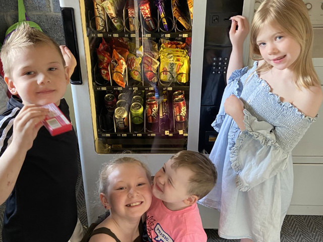 Mum buys a vending machine, fills it with snacks & says it's the best way to get kids doing their pocket money chores