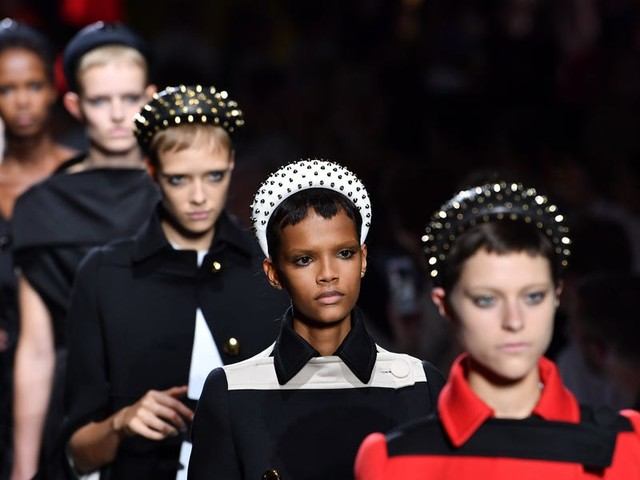 Prada just reached a settlement after its 2018 blackface controversy that'll mandate 'racial equity training' for employees — including the C-suite in Milan. But for some, that's not enough.
