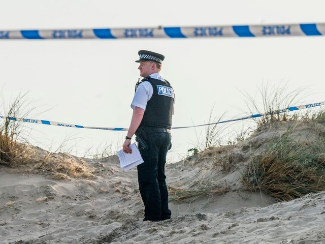 Boy, 14, stabbed as families enjoyed bank holiday sun at Crosby Beach