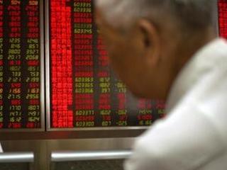 Asian shares gain, Shanghai up 2.4%, on Fed rate cut talk