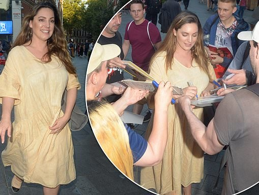Kelly Brook is mobbed by adoring fans while leaving Global Radio