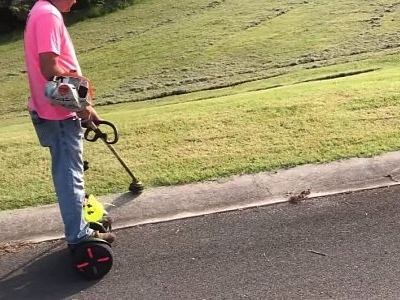 Genius Gardener Does Weedeating on a Segway Like a Pro