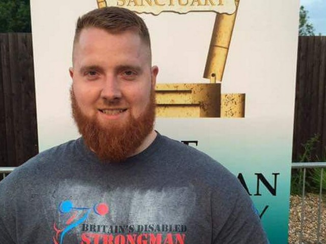 Dad crowned world's strongest disabled man may struggle to walk, but he can still pull a truck
