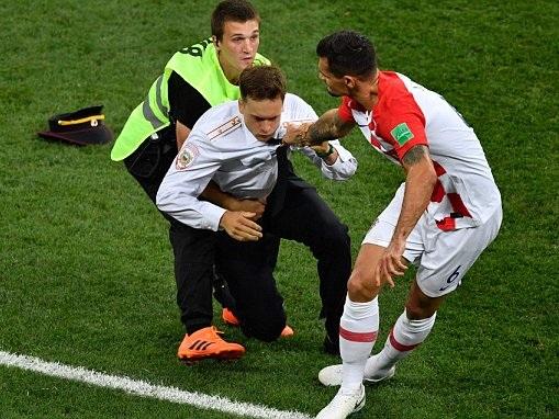 Croatia's Dejan Lovren speaks out after flooring pitch invader as protest interrupts World Cup final