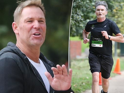 Shane Warne cheers on runners as Dave Hughes runs in Run The Tan charity fundraiser in Melbourne