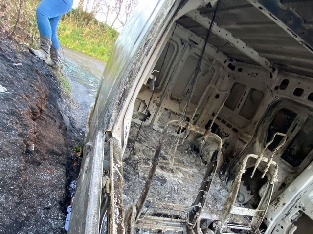 Burned out van found dumped in the river and leaking oil at beauty spot