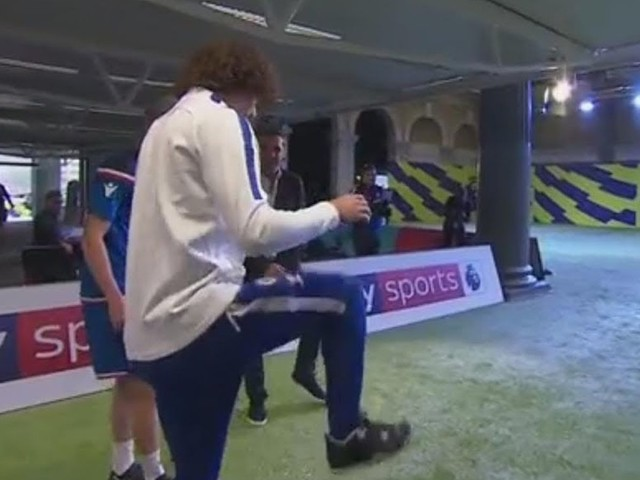 David Luiz explains his free kick technique to Gary Neville