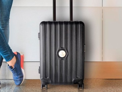 This $649 carry-on suitcase has an integrated Bluetooth speaker that uses the suitcase's walls as an amplifier — the same idea behind putting your phone in a cup to make it louder