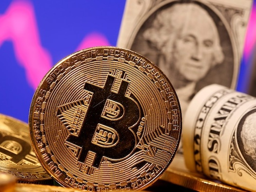 Bitcoin drops as much as 4%, sliding further from key $50,000 level