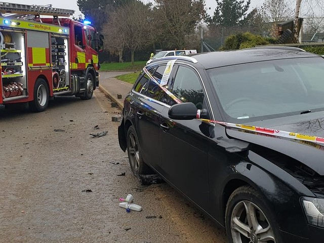 Audi crashes into gas outlet and wall causing leak