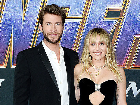 Miley Cyrus & Liam Hemsworth Pack On PDA At 'Avengers' Premiere — See Pics