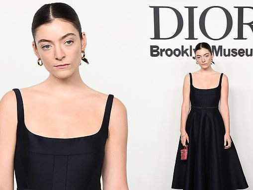 Lorde shows off her cleavage in a chic low-cut little black dress