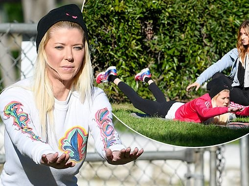 Tara Reid is put through her paces as she works out in the park