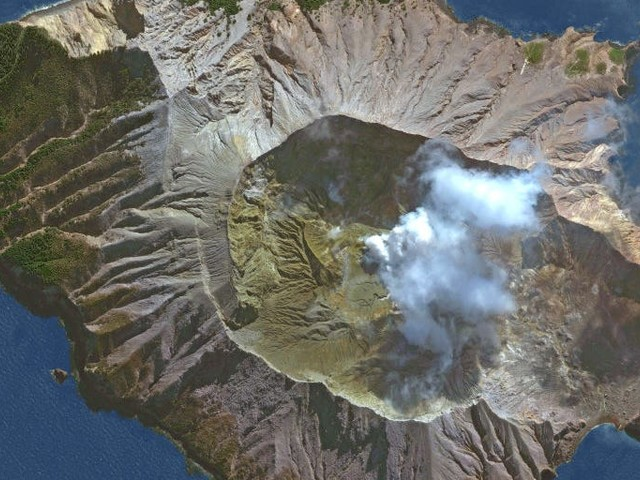 One of New Zealand's most active volcanoes erupts, sending plumes of smoke into the air