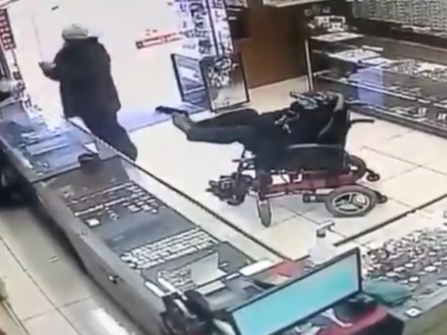 (Un)armed robbery: Wheelchair-bound man attacks jewelry store in Brazil brandishing gun with his FEET (VIDEO)