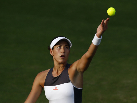 Muguruza survives scare in taking first step on grass