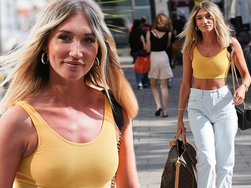 Megan McKenna displays her lithe physique in yellow crop top as she arrives at Kiss FM studios