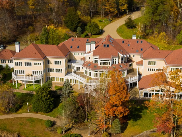 50 Cent was reportedly spending $70,000 a month on his 52-room Connecticut home. We asked 3 realtors to break down the 'invisible' costs of owning a mansion.