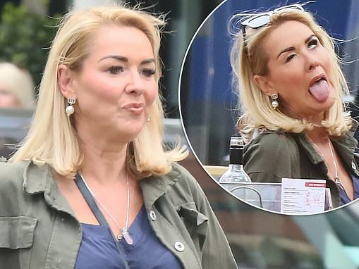 Claire Sweeney puts on VERY animated display as she enjoys al-fresco drinks with a friend