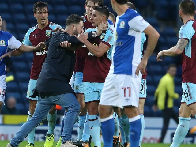 Burnley players rescue Jack Cork from Blackburn fan attack as thug storms pitch to grab star by the throat
