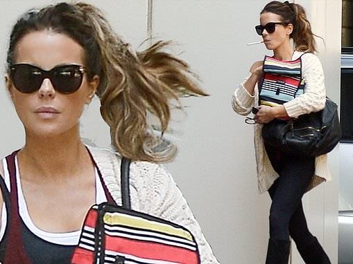 Kate Beckinsale goes casual cool in beige knit sweater as she juggles bags on smoke break in LA