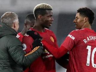 Man United beats Fulham 2-1, back atop Premier League