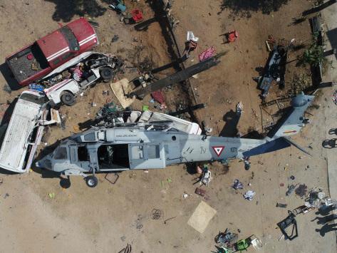 13 killed in minister's quake zone copter crash