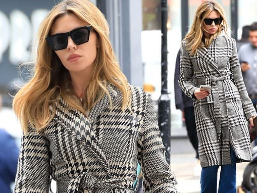 Abbey Clancy cuts a chic figure in a monochrome houndstooth coat