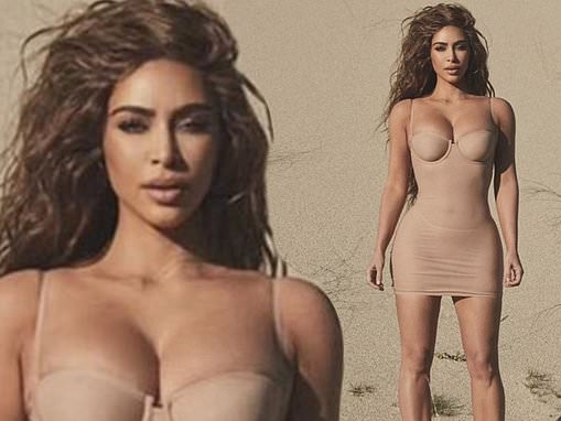 Kim Kardashian shows off her sculpted figure in a new Skims slip dress on Instagram
