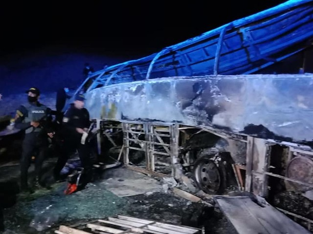 At least 20 killed in Egypt after bus crashes and catches fire