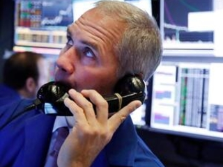Stocks open mostly lower on Wall Street; Wells Fargo sinks
