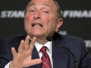 The Latest: Bettman set to announce format if NHL returns