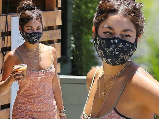Vanessa Hudgens strikes a pose in peach paisley dress and butterfly face mask while grabbing takeout