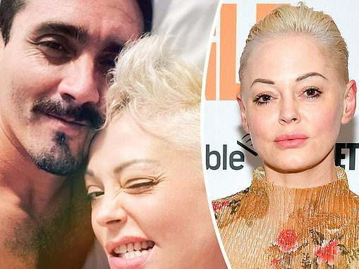 Rose McGowan flashes a grin as she lounges in bed with handsome mystery man during trip to Mexico