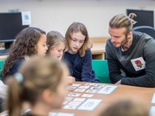 David Beckham Makes Surprise Visit To London School On World Children's Day