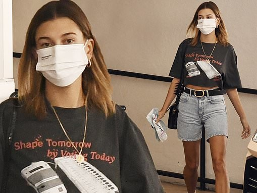 Hailey Bieber puts on a leggy display in LA as she urges fans to 'shape tomorrow by voting today'