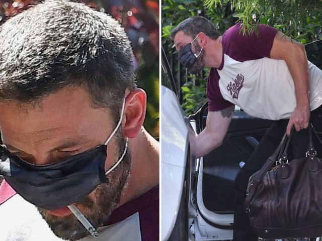 Ben Affleck lifts his face mask for a cigarette after kissing girlfriend Ana De Armas through the protective gear