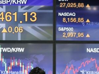 Asian shares fall back after China reports economy weakened