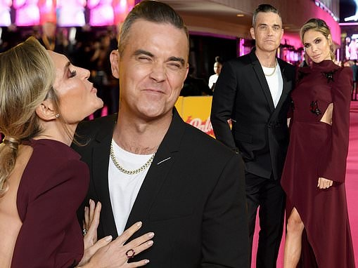 X Factor judges Robbie Williams and Ayda Field look loved-up at ITV gala