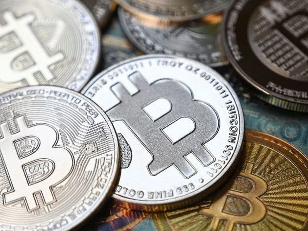 Crypto's explosive growth means investors must 'get on board, or be left behind,' says the ETF product manager at $71.2 billion VanEck — and these 5 stocks are ways to play the trend without owning volatile tokens directly